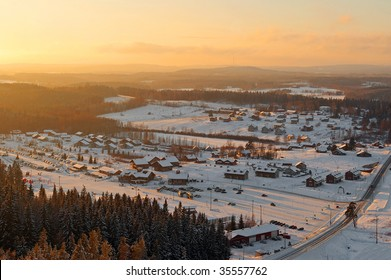 aerial view of nordic village on sunny winter evening
