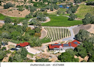 aerial view of northern california wine country near sonoma county with solar energy array on roof of building