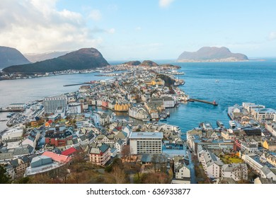 Aerial view of the norwegian town Aalesund, sea and mountains around.