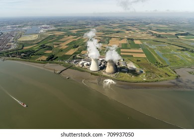 Aerial view of a nuclear powerplant in the city of Doel, Belgium. It lies at river Schelde, next to the harbour of Antwerpen.