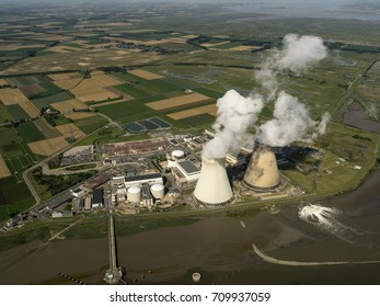 Aerial view of a nuclear powerplant in the city of Doel, Belgium. It lies at river Schelde, next to the harbour of Antwerpen. In the background the province Zeeland with the Hedwigpolder, Holland.