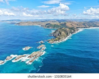 Aerial view of the nugget point lighthouse near Kaka Point in southern New Zealand