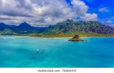 Aerial view Oahu's coastline and Chinaman's Hat island in Hawaii from a helicopter