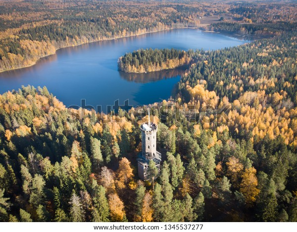 Aerial view of the observation tower in autumn landscape at Aulanko nature reserve park in Hameenlinna, Finland. Fall colors make trees look beautiful colorful