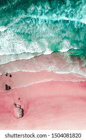 Aerial View Of Ocean Waves And Beautiful Pink Sandy Beach Shore