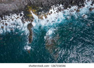 Aerial view to ocean waves. Blue water background. Photo made from above by drone.