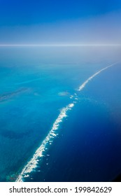 Aerial view of ocean waves breaking over the barrier reef in the Caribbean Sea off the eastern coast of Belize