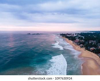 Aerial view of Oceanfront homes on a sandy beach Hikkaduwa sri lanka
