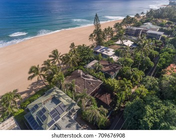 Aerial view of Oceanfront homes on a sandy beach in Hawaii