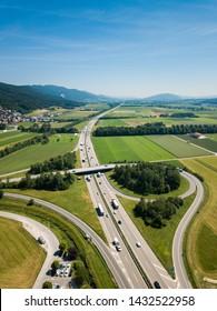 Aerial View Oensingen Switzerland Highway Intersection Traffic and Urban Sprawl close to Jura Mountains
