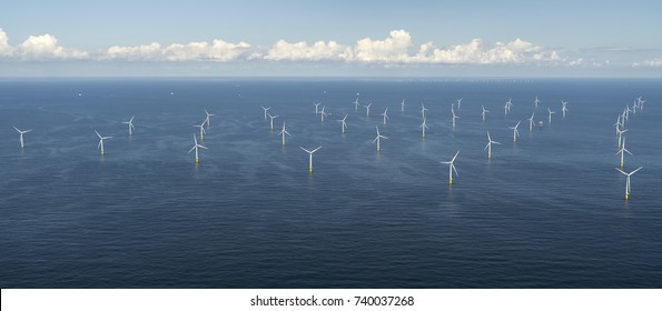 Aerial view of off shore windpark Luchterduinen. The windmills are in the Noordzee, 20 kilometers from the Dutch coastline between Noordwijk and Zandvoort. On the clear horizon a beautiful cloudstreet