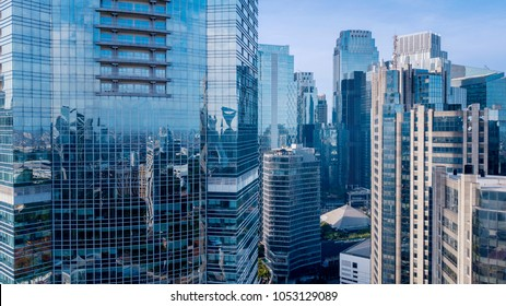 Aerial view of office buildings in Jakarta central business district, IndonesiaAerial view of modern office buildings under blue sky in Jakarta central business district, Indonesia