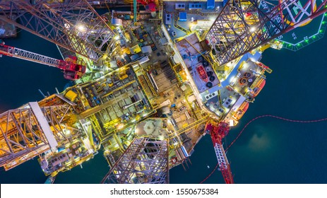 Aerial view offshore jack up rig at night, Offshore oil rig drilling platform, Maintenance.