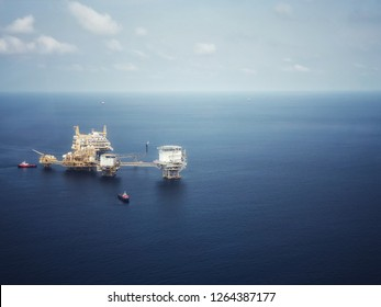 Aerial view of offshore living quarter platform or Offshore rig blue sky or Offshore oil and gas Accommodation Platform or Living Quarter and Production plant under a nice weather with supply boats