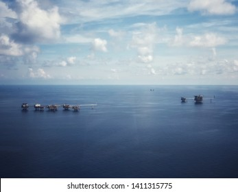 Aerial view of offshore living quarter platform or Offshore rig blue sky or Offshore oil and gas Accommodation Platform or Living Quarter and Production plant under a beautiful weather or blue sky