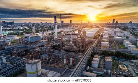Aerial view of Oil and gas industry - refinery at sunset - factory - petrochemical plant, Shot from drone of Oil refinery and Petrochemical plant at dusk , Bangkok, Thailand