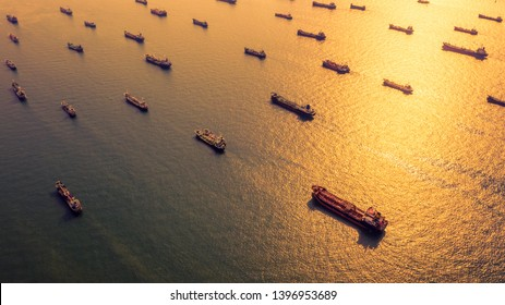 Aerial view oil and gas petrochemical tanker offshore in open sea, Refinery industry cargo ship, Oil product tanker and LPG tanker at sea view from above, Aerial view oil tanker ship at sunset.