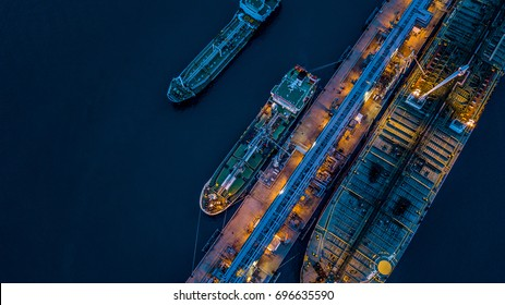 Aerial view oil and gas tanker cargo ship offshore at the port at night, Industry refinery fuel chemical import export business logistic and transportation.