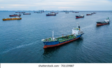 Aerial view of oil product tanker, LPG tanker and chemical tanker ship loading in port.