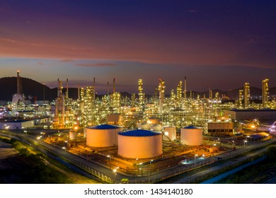 Aerial view. Oil refinery factory and oil storage tank at twilight and night. Petrochemical Industrial.