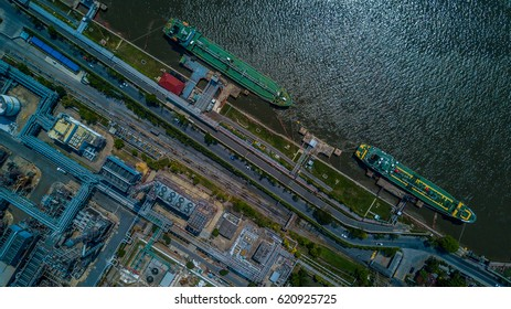 Aerial view Oil Refinery Industry and cargo ship moored on the river front.