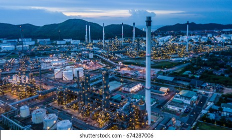 Aerial view oil refinery and natural gas and oil storage tank at night.