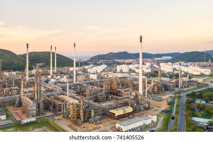 Aerial view Oil refinery.Industrial view at oil refinery plant form industry zone with sunrise and cloudy sky.Oil refinery and Petrochemical plant,Thailand. Oil refinery background sunset.