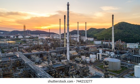 Aerial view Oil refinery.Industrial view at oil refinery plant form industry zone with sunrise and cloudy sky.Oil refinery and Petrochemical plant at dusk,Thailand. Oil refinery background sunset.