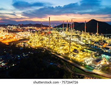 Aerial view Oil refinery.Industrial view at oil refinery plant form industry zone with sunrise and cloudy sky.Oil refinery and Petrochemical plant at dusk,Thailand. Oil refinery background sunset