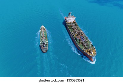 Aerial view Oil ship tanker move opposite directions for transportation from refinery on the sea.