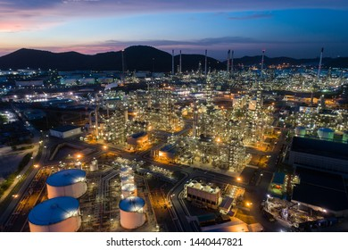 Aerial view oil storage tank with oil refinery factory industrial. Oil refinery plant at night. industry factory concept and transportation.