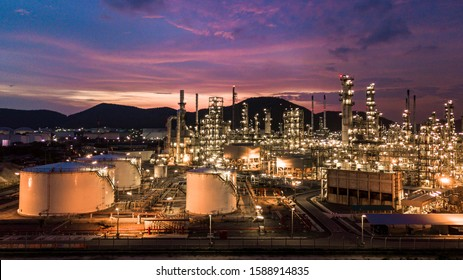 Aerial view oil storage tank with oil refinery background, Oil refinery plant at twilight.
