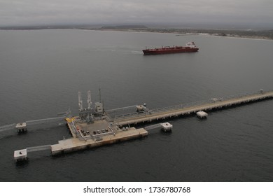 Aerial view oil tanker ship at the port, import export business logistic and transportation.