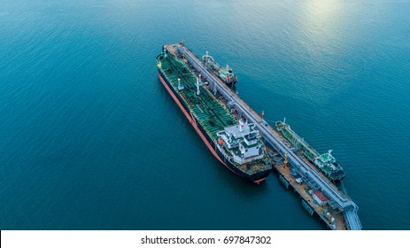 Aerial view oil tanker ship loading in port view from above, Tanker ship logistic import export business and transportation.