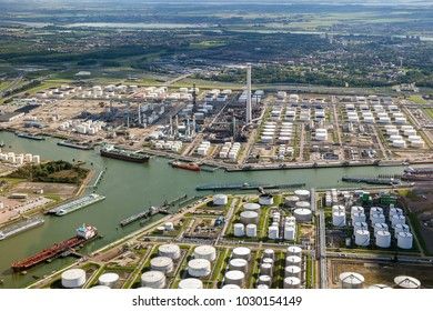 Aerial view of oil tankers moored at a oil storage terminal and oil refinery in a port.