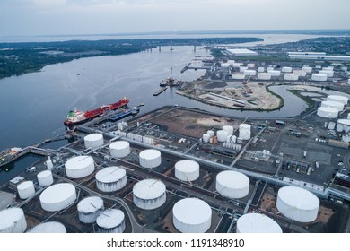 Aerial view of oil tankers and oil tanks docked on a river