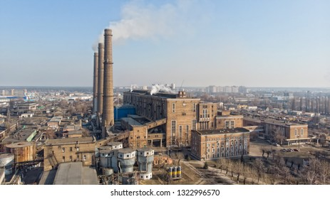 Aerial view of old factory with pipes