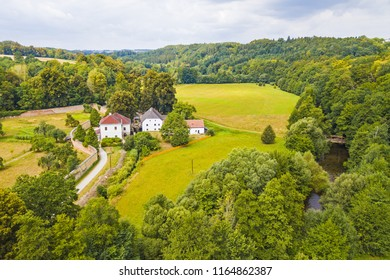 Aerial view of old mill known as Rudruv mlyn near river Upa in Ratiborice. Mill was founded in 16th century. Famous tourist attraction in Babiccino udoli from drone view. Czech republic, Europe. - Shutterstock ID 1164862387