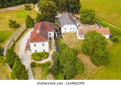 Aerial view of old mill known as Rudruv mlyn near river Upa in Ratiborice. Mill was founded in 16th century. Famous tourist attraction in Babiccino udoli from drone view. Czech republic, Europe. - Shutterstock ID 1164862390