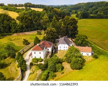 Aerial view of old mill known as Rudruv mlyn near river Upa in Ratiborice. Mill was founded in 16th century. Famous tourist attraction in Babiccino udoli from drone view. Czech republic, Europe. - Shutterstock ID 1164862393