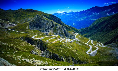 Aerial view of the old road called Tremola with many serpentines going through the St. Gotthard pass in the Swiss Alps