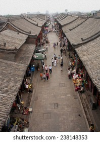 Aerial view of an old street in Pingyao ancient town, china,  stylized and filtered to resemble an oil painting