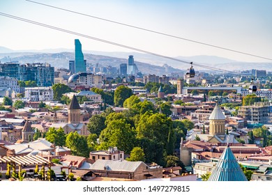 Aerial view of Old Tbilisi from Narikala Fortes. Skyline of the city and cable car. Georgia