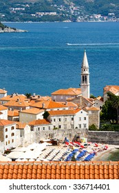 Aerial view of the Old Town Budva in Montenegro. Beautiful architecture and tiled roof of Medieval town Budva, Montenegro, Europe.