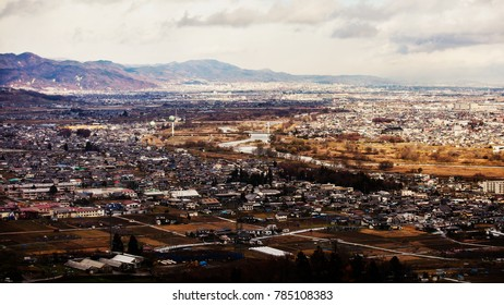 Aerial view of old town, mountains in the background