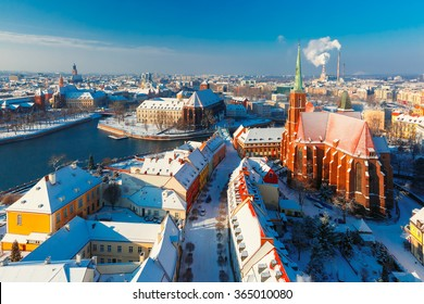 Aerial view of Old Town and Ostrow Tumski with church of the Holy Cross and St. Bartholomew from Cathedral of St. John in the winter morning in Wroclaw, Poland