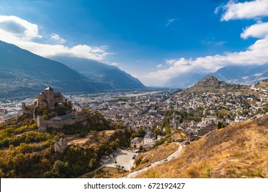 Aerial view of the old town of Sion city and the Valere Basilica from the Tourbillon castle on a sunny day, canton of Valais, Switzerland