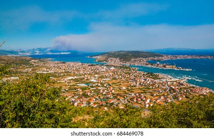Aerial view of Old Town of Trogir, Croatia. In the distance Forest fire.
