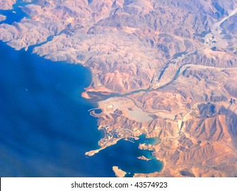 Aerial View of Oman Coastline taken from 35000 ft in the Air showing Qaboos Port & Surroundings.
