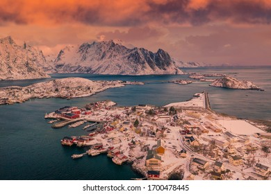 Aerial view with an ominous sunset sky over Reine, Lofoten islands, in winter